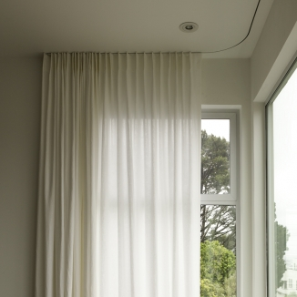 modern curtains on built-in ceiling track