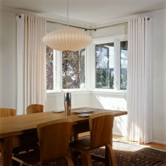 White modern curtains in a modernist dining room in San Francisco