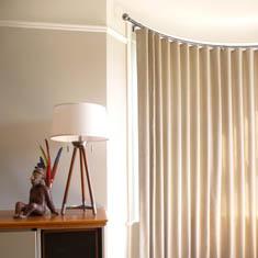 Bowed window with contemporary window drapery