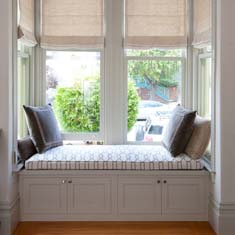 Custom built in seating and storage by Stitch