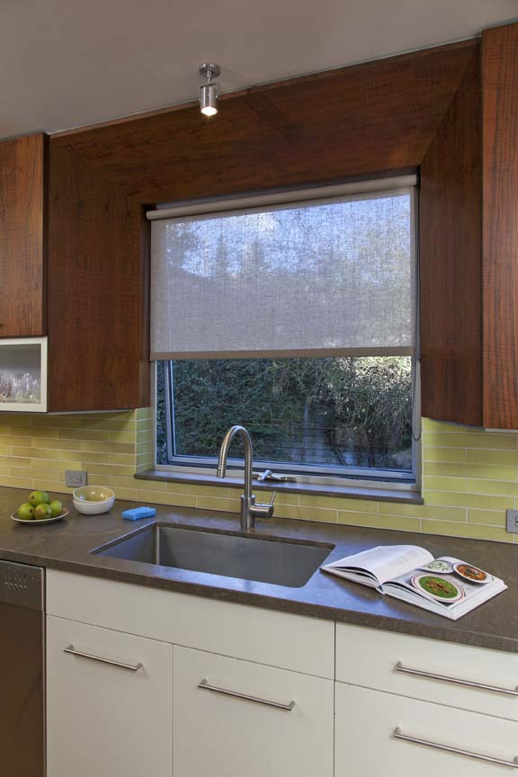 Subtle kitchen window roller shade that respects for Window design solutions